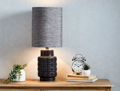 Complete your room with our stylish collection of lighting solutions. Shop our range of lanterns, table lamps and candles, online or in-store at Bed Bath N' Table. Candle Lamp, Candle Lanterns, Soy Candles, Candles For Sale, Black Table Lamps, Style Challenge, Bedside Lamp, Lighting Solutions, Black And Grey