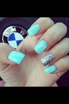 Solid baby blue nails with silver glitter accent nail.