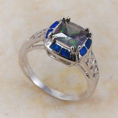 'Genuine Blue Fire Opal and Enhanced Rainbow Topaz Ring' is going up for auction at  6am Sun, Jun 30 with a starting bid of $10.