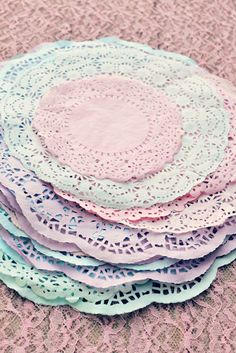 Dye doilies with food coloring.     (Can do some with black to keep w/black & white theme?)