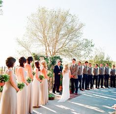 like the idea of groomsmen only wearing vests. cute for spring/beginning of summer wedding :)