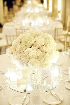 short white centerpiece on round mirror makes the perfect accent to your table #wedding #decor