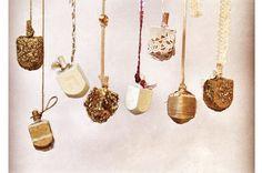 I like the idea of decorating your dreidels... Vintage dreidels on twine and pretty ribbon.