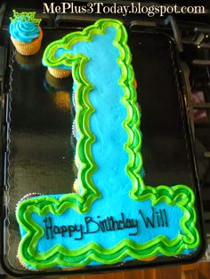 Baby Boy's First Birthday Party! Blue and green cupcake cake shaped like the number 1.