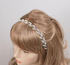 The silver plated high quality rhinestones is secured with a white double-sided satin ribbon that ties into a bow at the base of the neck.  * high