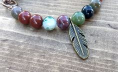 Indian Agate with a Feather Charm by NidraBeads on Etsy Indian Agate, Spiritual Jewelry, Feather, Jewelry Making, Beaded Bracelets, Charmed, Trending Outfits, Beads, Unique Jewelry