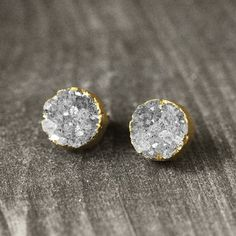 stud earrings.