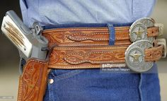 Special Ranger Wayne Goodman wears his Colt 1911 with a double belt with double belt buckles designed from his badge at the Dublin Livestock Auction, March 2014 in Dublin, Texas. 1911 Leather Holster, 1911 Holster, Custom Leather Holsters, Gun Holster, Custom Belt Buckles, Firearms, Shotguns, Revolvers, Cowboy Gear