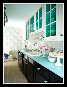 Eventually every kitchen needs work to look fresher and work better. Fun or functional, these 15 do-it-yourself ideas will put a new face on your place. What a color scheme! Pastel teal paint on ceiling and inside cupboards and teal glass knobs; black base cabinets on bottom & white-glass-fronted cabinets on top. Add the b-board & teal tile full backsplash, and the painted rug floor path and enjoy.  #lauraashleykitchens