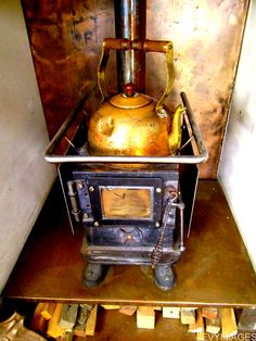 love the wood stove... and the copper wall and floor protection with wood bin underneath...
