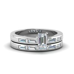 Shop baguette bar with emerald cut diamond wedding set in white gold at Fascinating Diamonds. This diamond engagement ring is designed in Bar setting Baguette Diamond Wedding Band, Unique Diamond Engagement Rings, Baguette Diamond Rings, Diamond Wedding Sets, Rose Gold Diamond Ring, Best Diamond, Emerald Cut Diamonds, Diamond Cuts, Pretty Wedding Rings