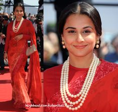 In a red Sabyasachi sari, she attened the latest premiere at Cannes. The same pulled back hair, fresh, dewy make-up, jewelry by House of Surana and a Ferragamo bag completed her look.
