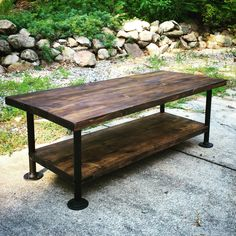 Industrial style wood coffee table with steel pipe legs