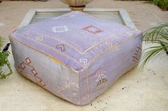Moroccan Kilim Pouf, refashioned from a vintage Berber rug (P108b)