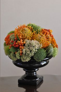 Different elements available in the fall for a flower arrangement - Pincushion, Cucumis