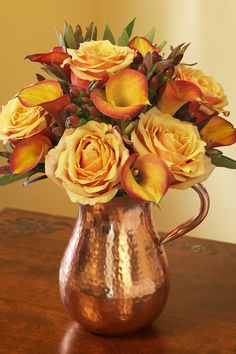 Pitcher Perfect | Julie's Floral Lifestyle Blog...luv these golden/coppery flowers in a hand crafted copper pitcher...