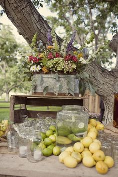 love everything about this...wildflowers, galvanized tin bucket, and lemonade!