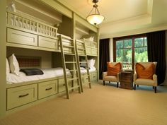 Green painted built-in bunk room with six large under bed storage drawers.