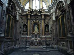 "San Domenico Maggiore, Naples.  The Chapel of Zi Andrea.  The Baroque appearance from the 17th century is by Andrea Malasomma and Costantino Marasi.  Prior to this time, this chapel had as its altarpiece a painting by Caravaggio ""Flazellazione di Cristo"" of 1607."