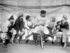 Babe Ruth 1924 -- Ruth, the most popular athlete of his era, poses with a group of children.