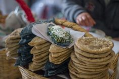 Tlacoyos are a popular food in Mexico CIty. They are corn masa paddies stuffed with beans, cheese or fava beans and topped with cactus and salsa.