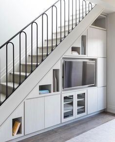 Tara Fingold Interiors under stairs millwork builtin Staircase Interior Design, Small House Interior Design, Home Stairs Design, Home Building Design, Home Room Design, Staircase Storage, Stair Storage, Hidden Storage, Living Room Under Stairs