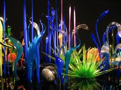 Saw something like this at the St. Petersburg Chihuly museum...but the most amazing part of it was looking down at that polished black base and seeing the reflection of the glass as though  looking at magical stalactites descending into a dark cave.  Wonder-full.