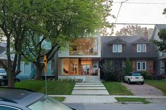 A modern house in Toronto. Unlike most of its traditional neighbors, the facade is modern, inviting, and transparent.