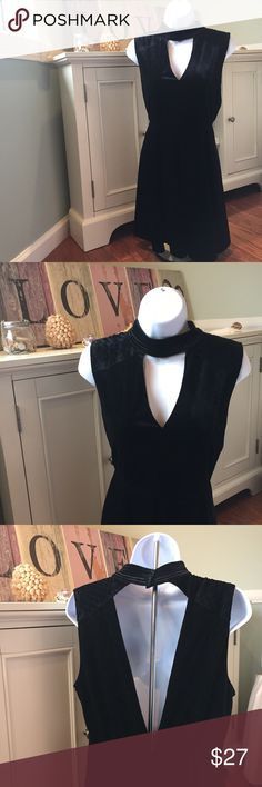Very J Black Velvet V Neck Choker Dress Like new condition! Only worn once. Lovely Black Velvet dress with a deep v neck. Also features a high neck Choker. Zips up in back. Shoulders also have lovely detailing. Built in slip underneath. Great quality! Let me know if you have any questions. Very J Dresses Mini