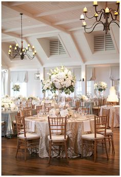 gold ivory and white wedding reception decor with white florals in glass vessels place - Wedding Reception Decor