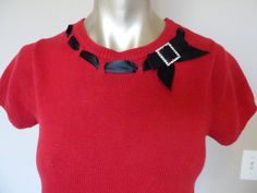 Vintage Holiday Sweater Red with black ribbon trim & rhinestone feature Short sleeve Length from shoulder to hem 24 inches Bust 34 Sleeves 6 inch length No stains, pulls, rips or flaws EXCELLENT VINTAGE CONDITION Red Sweaters, Holiday Sweaters, Black Ribbon, 1990s, Vintage, Sleeves, Cotton, Etsy, Fashion
