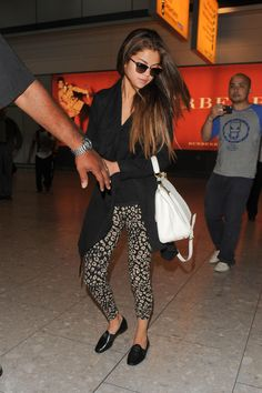 Selena Gomez keeps it casual in a pair of cropped leggings and black sweater after arriving at Heathrow Airport in London http://aol.it/14VC6a3