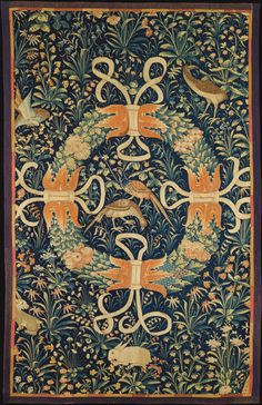 Wreath on a Ground of Flowers, Birds, and Rabbits Date: ca. 1490–1550 Culture: South Netherlandish Medium: Wool warp, wool wefts Dimensions: Overall: 79 x 49 in. (200.7 x 124.5 cm) Classification: Textiles-Tapestries