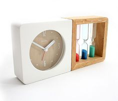 HOURGLASS ALARM CLOCK by GeekCook // Using a concealed magnetic connector, the two-in-one timepiece unites three old-fashioned sandglasses with a modern alarm clock. The red, blue, and green hourglasses that last for one, three, and five minutes. #productdesign