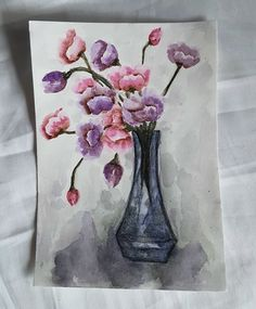Colorful flowers in a blue glassvase in aquarelle paint