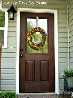 "Gel Stain Fiberglass Door 1 to look like wood. From ""Lovely Crafty Home""."