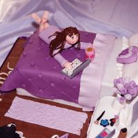 The Teenage Bedroom cake - This cake is for a little girl who turned 13, covered all the elements they wanted a chocolate dressing table and bed, her dog she grew up with, make up, her favourite colour purple and 1 purple roses.  Also has her book, laptop cup of hot chocolate, monogrammed cushion, balloons with her age on, her long brown hair and lilac dressing gown.