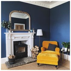 Bright butterscotch yellow velvet, deep blue and bright whites are the perfect colour combination. has created the perfect cosy corner with the Bluebell armchair and matching footstool. Mustard Living Rooms, Navy Living Rooms, Blue Living Room Decor, Living Room Color Schemes, Blue Rooms, New Living Room, Blue Walls, Living Room Designs, Blue And Yellow Living Room