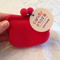 red silicone coin purse Cute coin purse by Candy Store. Hold change or store any smaller items in your purse or car. Little girls would also appreciate this cute little coin holder. I can bundle this for you for less! Bags