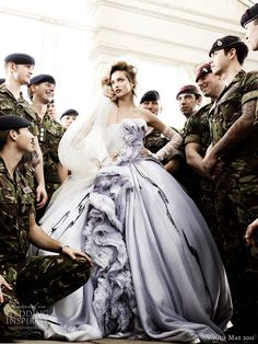 dior wedding dress vogue mario testino - model Karmen Pedaru in an embroidered off-white silk and grey degrade tulle dress by Dior Haute Couture, surrounded by soldiers, shot by photographer Mario Testino for British Vogue royal wedding issue may 2011