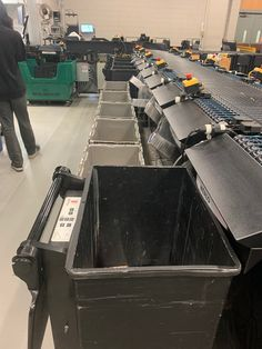 TechLogic sorter at Chicago Public with a combination of SmartBins (black bookdrop bin in foreground), and totes (grey). There are also big moveable trolleys (not seen in this picture) used at some sort destinations. Totes, Destinations, Chicago, Public, Big, Grey, Outdoor Decor, Black, Gray
