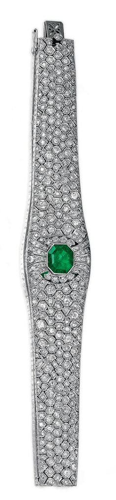 EMERALD AND DIAMOND BRACELET.  The tapering band of honeycomb pattern millegrain set with circular- and single-cut diamonds, set at the centre with an octagonal emerald, mounted in platinum,  French assay and maker's marks, one diamond deficient.  length approximately 185mm,