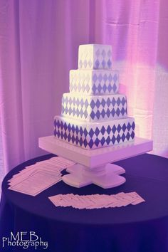A display cake for a recent wedding show created for a fellow vendor to help them demonstrate pin lighting for cakes.  It was my first try at the ombre style which is becoming popular.