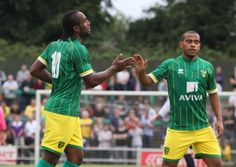 Cameron Jerome is congratulated by Louis Thompson after opening the scoring for Norwich City at Hitchin on Tuesday night.  Picture by Paul Chesterton/Focus Images Ltd