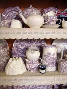 Tennessee lovely lavender and white plates and tea pots on shelves edged with white lace shelf edging