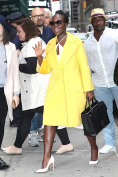 Lupita Nyongo embraces bold color for the transition to fall.