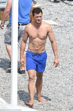 Causing a splash! Jamie looked effortlessly hunky in a pair of thigh-skimming electric blue shorts, which showed off his impossibly muscular legs