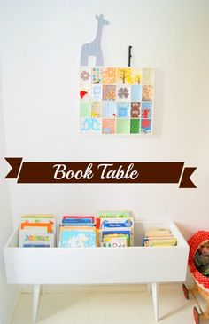 How about a low table filled with rows of kids books? Not a bad idea. I am in love with this table. Those legs!   Instructions at http://dejligheder.blogspot.com/2011/09/brnebibliotek-i-stedet-for-seng.html