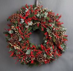Wild at Heart Classic Red Berry Wreath. This traditional red berry wreath uses ilex berries, pine cones, pussy willow and eucalyptus. Christmas Door Wreaths, Christmas Room, Christmas Lights, Christmas Holidays, Christmas Crafts, Christmas Decorations, Wooden Wreaths, Wreaths And Garlands, Red Berry Wreath