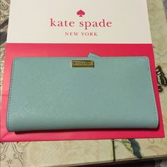 Baby blue wallet Stacy wallet, I'm in love with the color, fits enough cards for when you hit the club or are running a quick errand. Measures 6.5x3.5 kate spade Bags Wallets